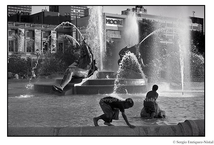 Children Playing at the Fountain of the Three Rivers in Logan Circle, Philadelphia, Pennsylvania, USA